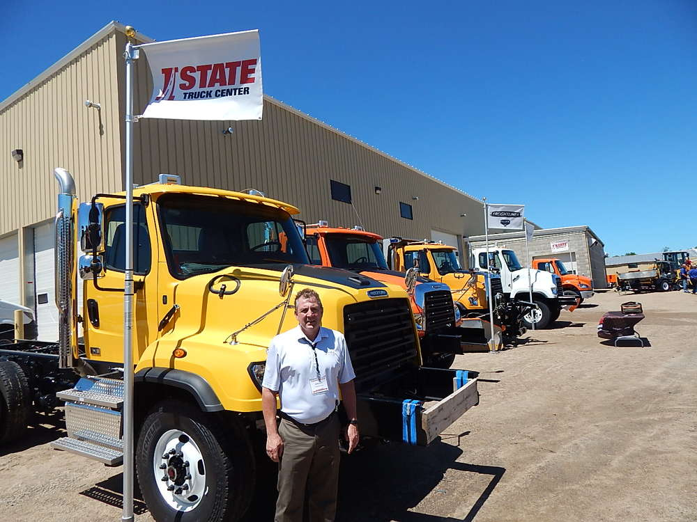 Andy Rice, sales manager, I-State Truck Centers, Inver Grove Heights, Minn., stands with a complete line of in stock trucks ready to work.