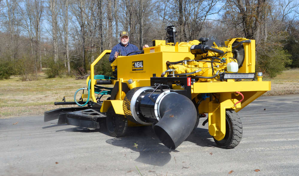 Neal Manufacturing's DA-350 features a blower that produces more than 6,000 cfm, triple the output of a typical walk-behind blower, for fast and thorough dirt and debris clearing