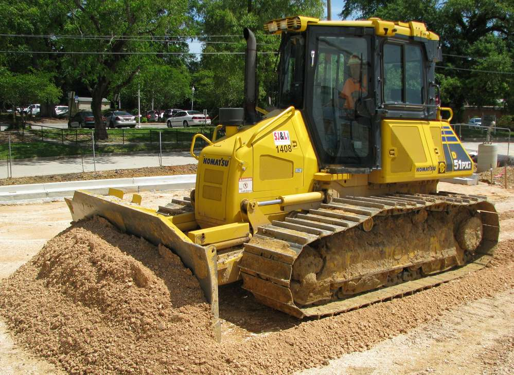 SJ&L Inc. Civil Contractors uses a Komatsu D51PXi for precision grading and contouring on a professional office building job site in Mobile, Ala.
