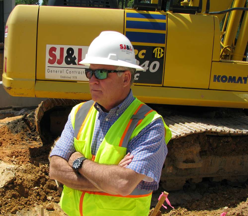 Michael Tew, president of SJ&L Inc. Civil Contractors, monitors the progress of the company's job sites.