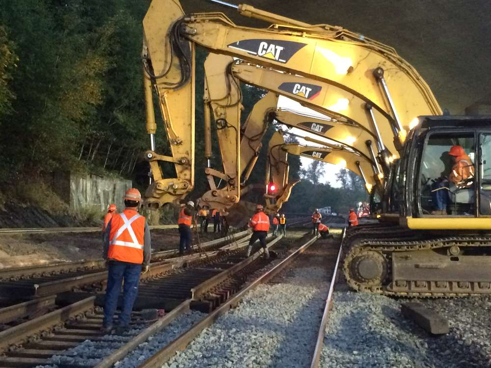 Excavators lower part of a turnout track near Nisqually as part of the new route trains will use in and out of Tacoma.