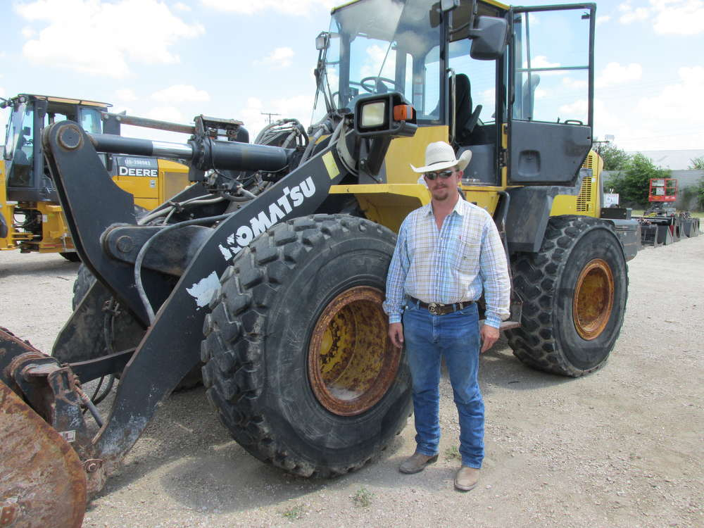 David Smith, an independent contractor of Goldthwaite, Texas, considers bidding on this Komatsu WA 250 PZ loader.
