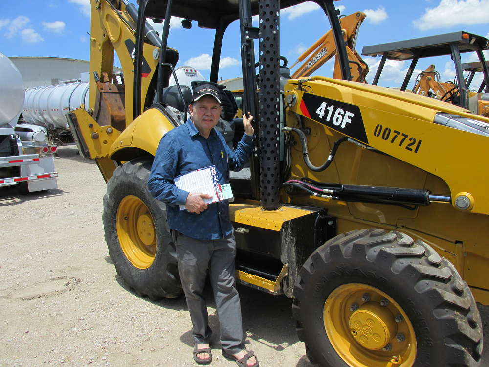 Jose Hernandez, Mid-Tex Equipment of Hidalgo, Texas, is pretty sure this Cat 416F loader/backhoe is the machine he wants to bid on.