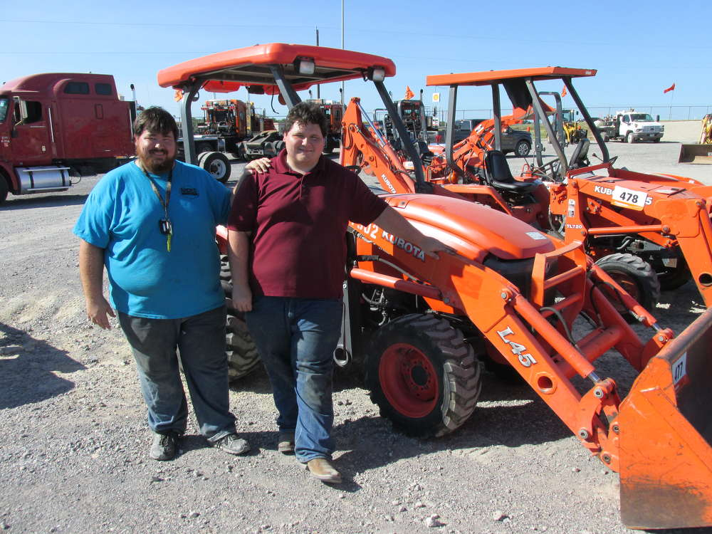Garrett (L) and Westen Champlain, Andes Farms of Winfield, Kan., think this Kubota loader/backhoe will be the perfect fit for the project on the farm.