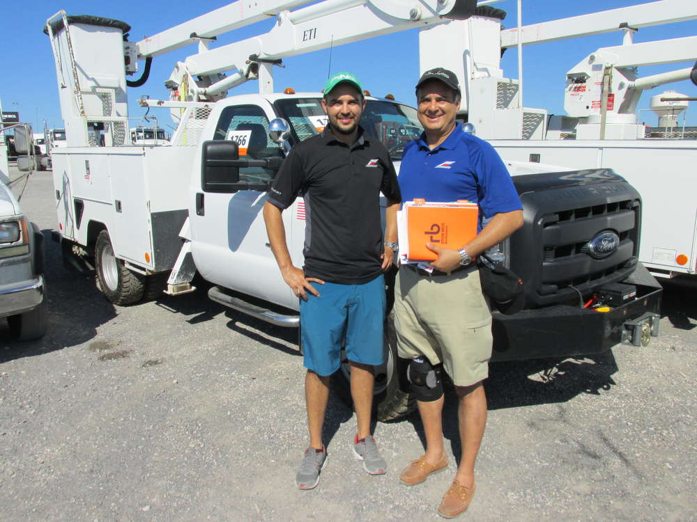 Fernando Aceves (L) and his father Juan Aceves, FA Motorcars in San Antonio, Texas, are ready to bid on this Ford 350 bucket truck.
