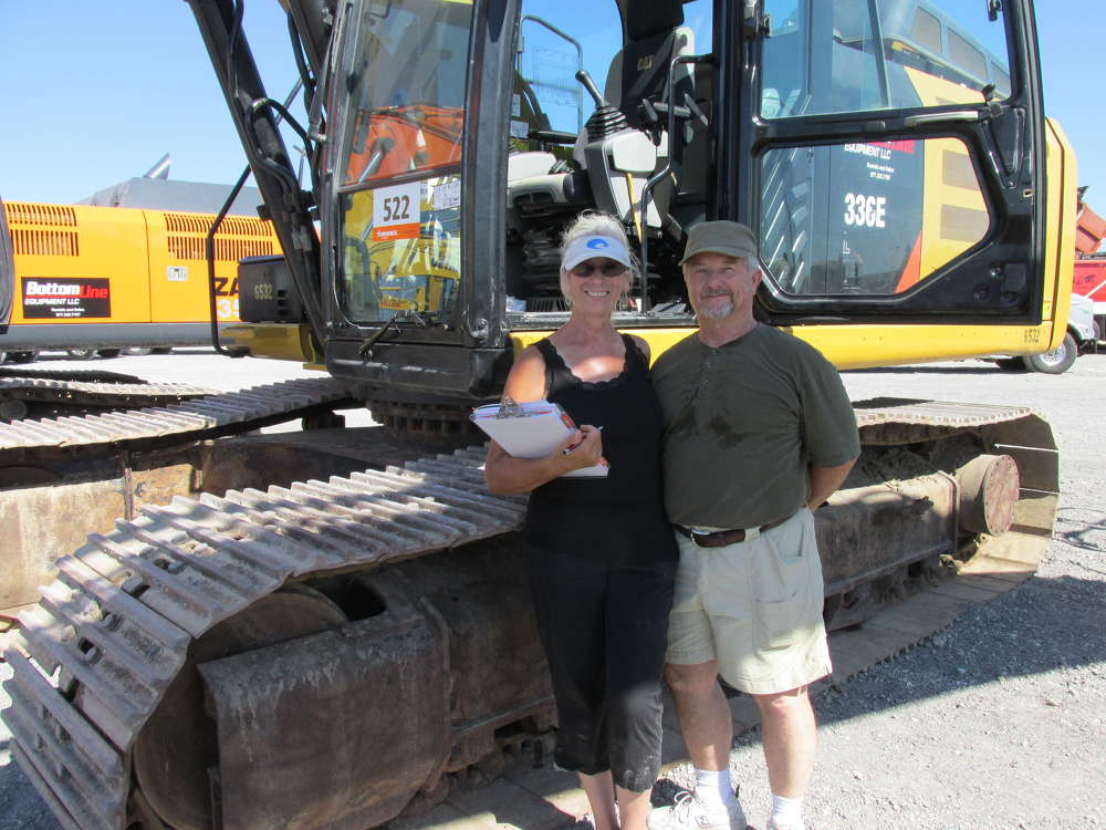 While on their honeymoon, Sara (L) and Dana David Jones, Grassroots Cattle Company LLC of Barwick, Ga., thought they would see about adding this Cat 336E excavator to their equipment base for the ranch.