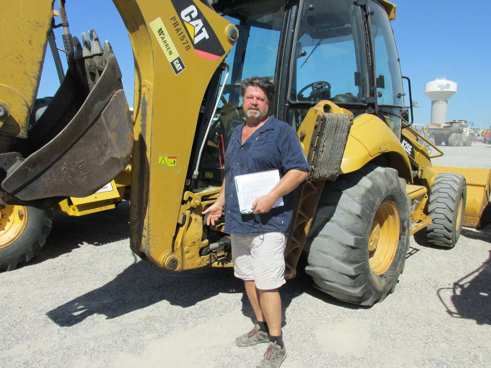 Kirby Bond of ZIA Ice Company, Elephant Butte, N.M., has a personal use for a Cat 420E loader/backhoe just like this one.