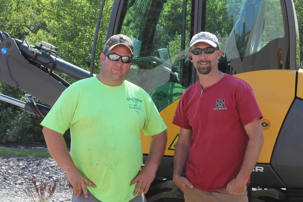 D'Arcy Cleveland (L), owner of D'Arcy Cleveland & Sons Excavation, Pawcatuck, Conn., and Ben Holmes, owner of Rye Beach Landscaping, Exeter, N.H., attended Lorusso Heavy Equipment's demo day. Both had the opportunity to test the MCR skid excavator in person after seeing demonstrations online.