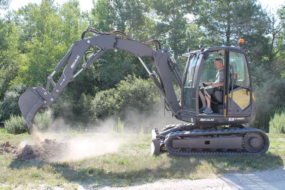 This compact excavator that doubles as a skid steer has a 24 ft. (7.3 m) reach, making it one of the most versatile machines available.