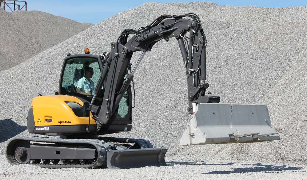 With the fork attachment the Mecalac can easily place jersey barriers around the job site.