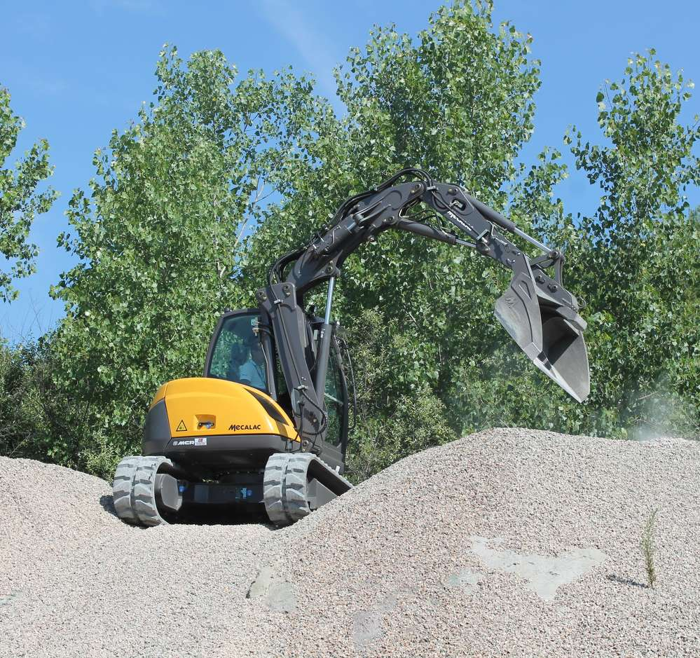 The Mecalac is a versatile machine, combining a skid steer loader with the reach of an excavator.