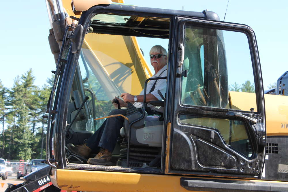 Ronald Loiselle of Chelmsford, Mass., is checking out this Cat 330D excavator to expand his fleet.