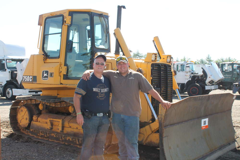 John Vasel III (L) and his son, John Vasel IV of J.V. III Construction Inc., Rocky Hill, Conn., are interested in this John Deere 750C dozer.