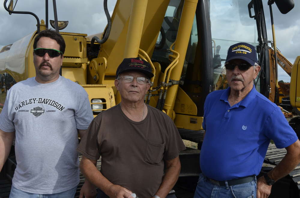Looking to give this Caterpillar excavator a new home (L-R) are Ken Sapp from Sodus, N.Y.; Ken Yager from Williamson, N.Y.; and Bob Sapp from Sodus, N.Y.