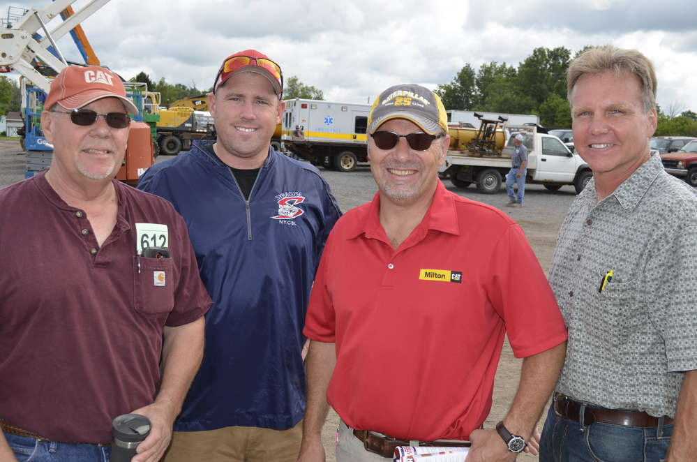 With this many late model Caterpillar machines at the auction, representatives of Milton CAT could not resist the opportunity to seek out future Cat customers. (L-R) are Brad Townsand of BB & T Inc., Cato, N.Y.; Austin Townsand from Cato, N.Y.; Steve Earl of Milton CAT; and Steve Burnett of Right Rentals, Locke, N.Y.