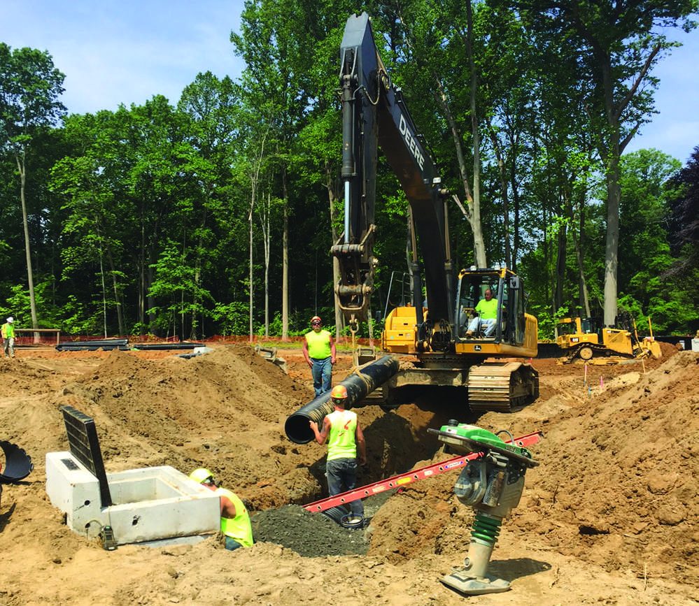 The Reserve At Maybrook in Montgomery County will be a 251-unit multi-story residential project on 36.3 acres being prepared by Schlouch. Here a pipe crew installs storm sewers.