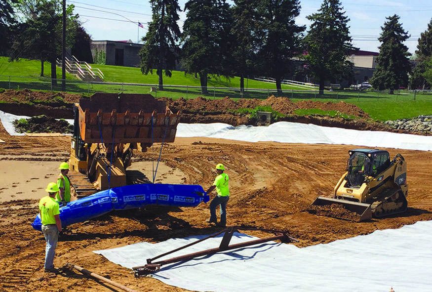An SI crew installs a pond liner as part of the work being done on the athletic fields at Freedom High School in Bethlehem.