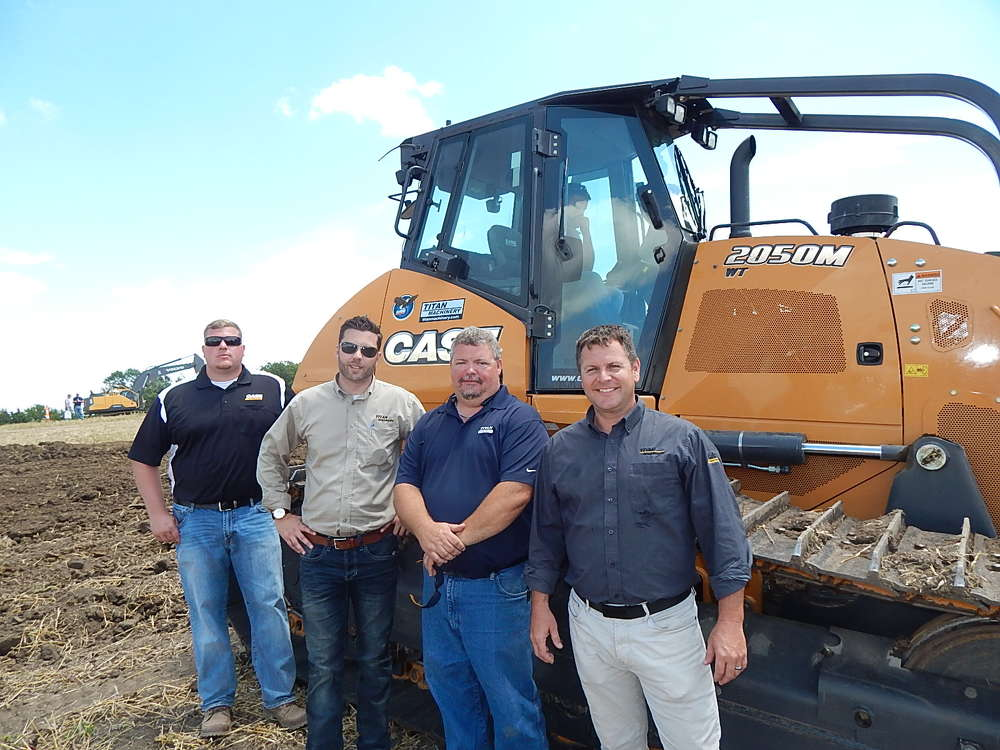 (L-R): Ryan Pluta and Mike Misner, Titan Machinery, Omaha and Lincoln, Neb., field marketers;  Ed Lahmann, Titan Rents account manager; and Barry Spencer, store manager,  talk about this Case 2050M dozer.