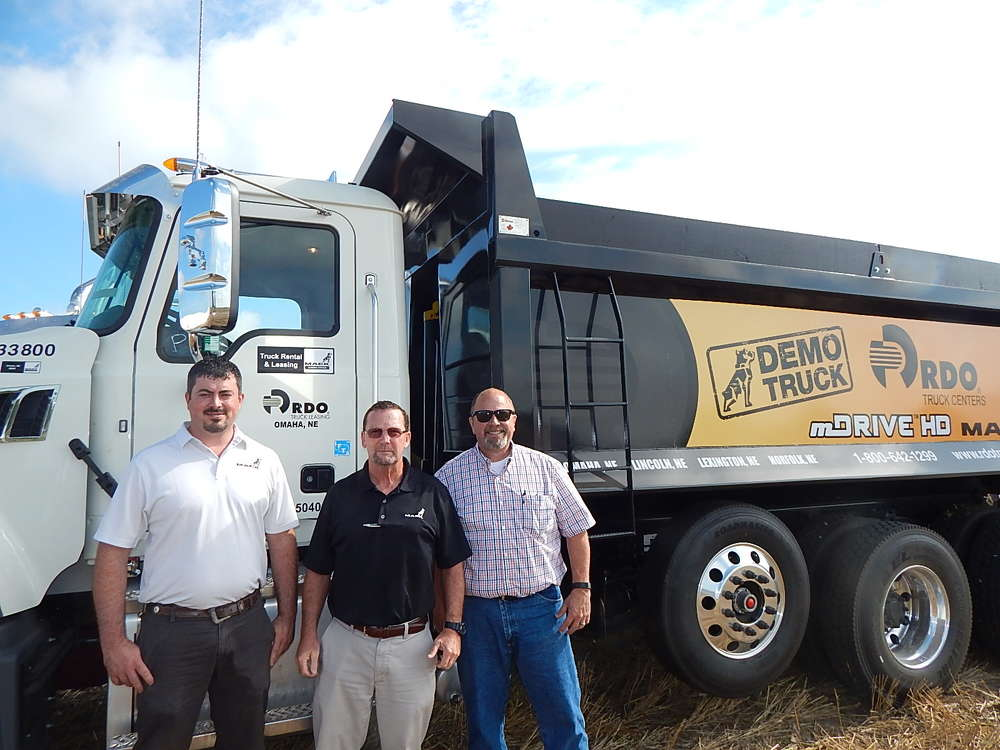 (L-R): Phil Schneider, sales representative, T.J. Novak, store manager, and Randy Sutton, sales, all of RDO Truck Centers, Lincoln, Neb., showcase the 2017 Mack demo truck on site.