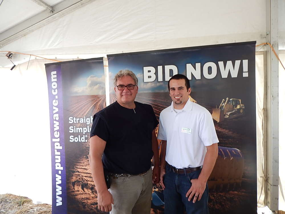 Scott Wiese (L),  territory manager, and Curt Compagnone, both of Purple Wave, attend the event.