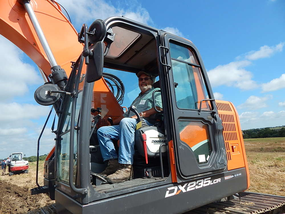 Tom Borchers, assistant foreman of Madison County, Neb., tests this Doosan DX 235LCR excavator from Omaha Tractor & Equipment, Omaha, Neb.