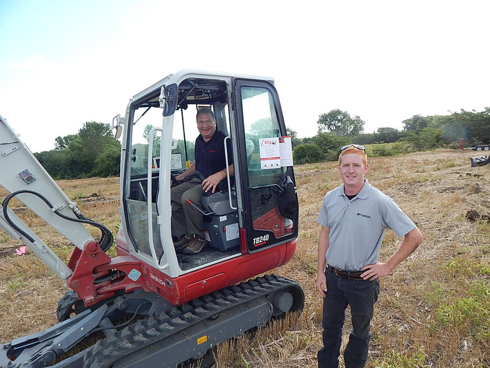 John Bachtell (L), DK&B Construction Specialties, LaVista, Neb., learns about this Takeuchi TL12 from Jeff Vodnik, Takeuchi regional product manager.