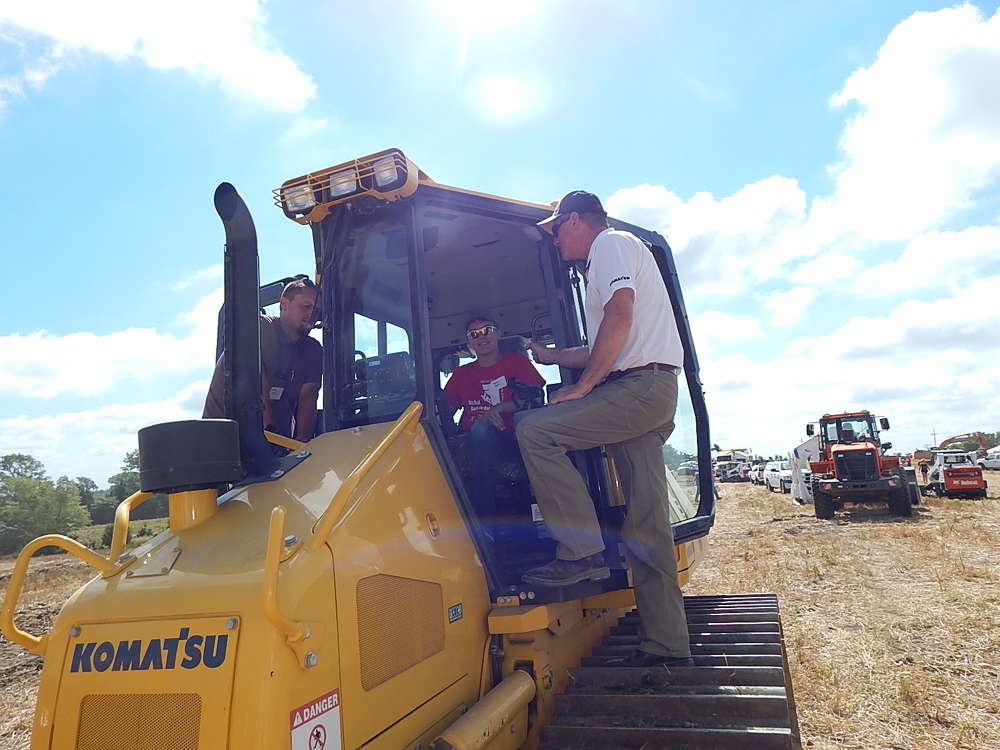 Dean Alfers (R), sales, Road Builders, Norfolk, Neb., helps  Seth Cech, equipment operator of Cech Excavating, Clarkson, Neb., with this  Komatsu D51PXi 22 dozer.