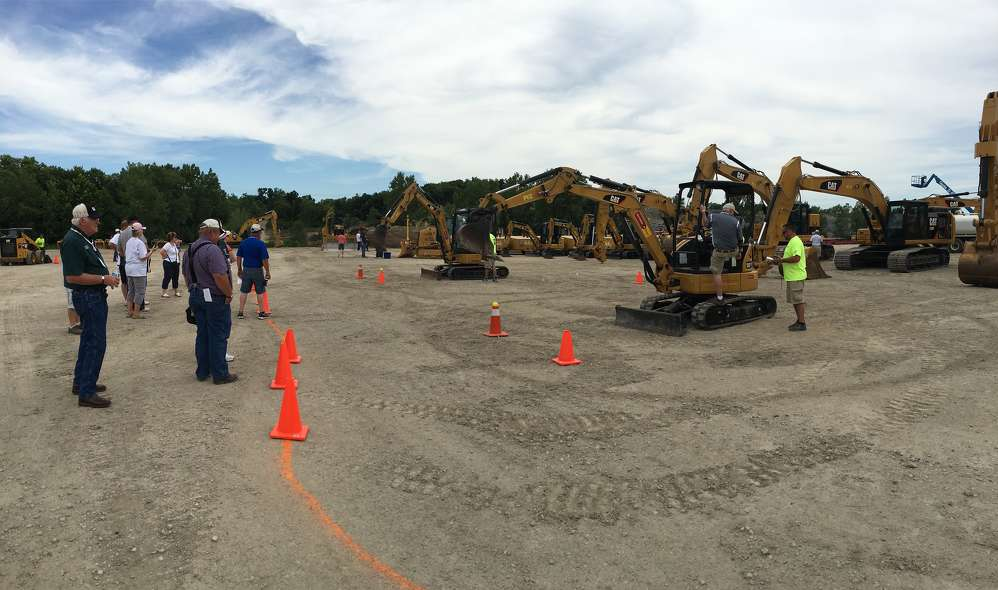 """LICA members compete in the Mini-Excavator Challenge, part of """"The Contractor Games."""""""
