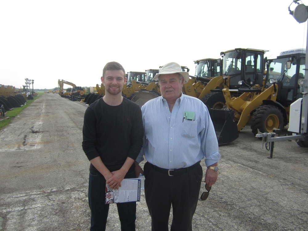 Jacob Alexander (L) learns about the industry from his grandfather, Jerry Alexander, founder of Alexander Equipment Rental in Bourbonnais, Ill.