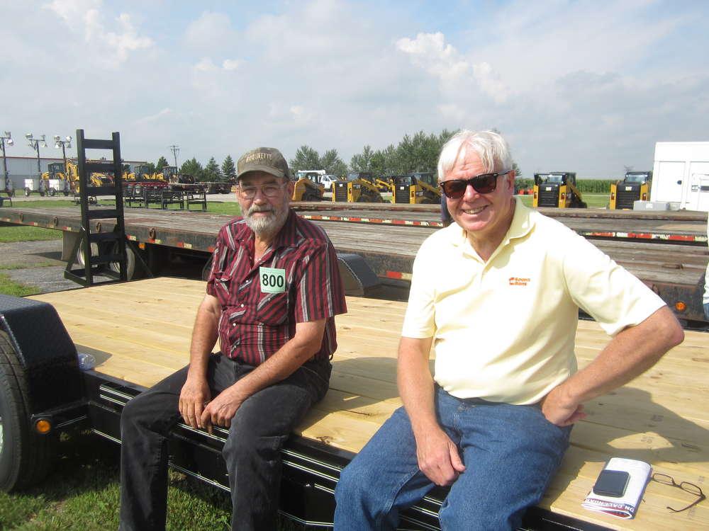 John Robinette (L), Robinette Demolition, and Art Bayley, 1st Source Bank, talk about the industry.