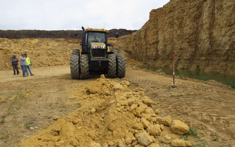 The operator prepares to demonstrate the  FAE STCH-250 rock crusher and MTH-225 attachments.