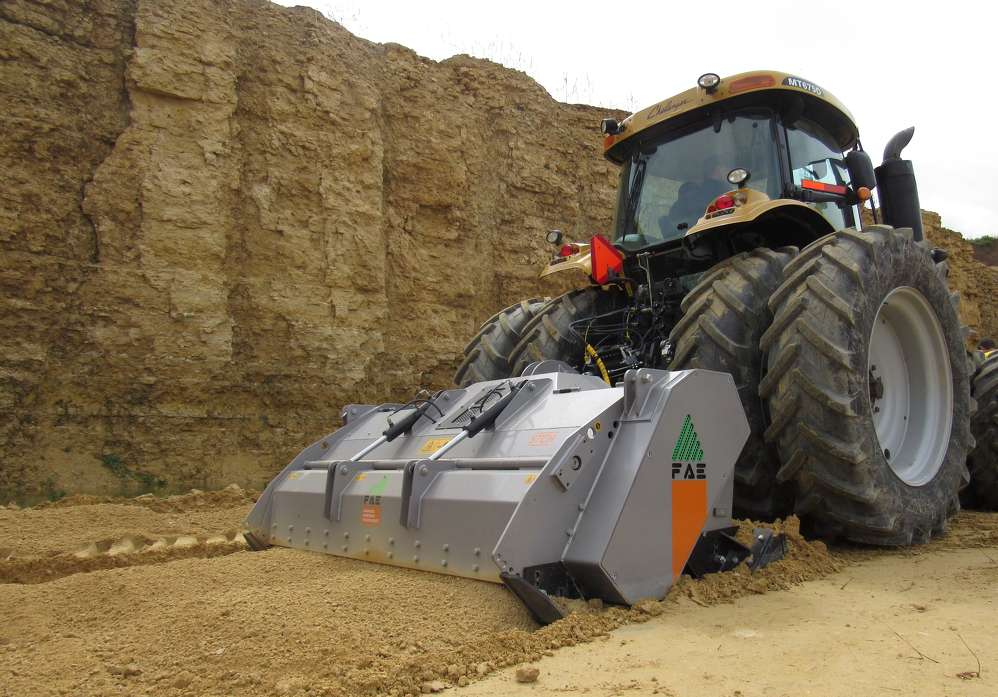 The operator demonstrates the FAE STCH-250 rock crusher.