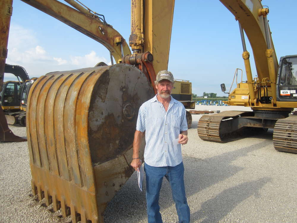 Donald DeSomer, owner of DeSomer Trenching Service in Mulkeytown, Ill., shops the selection of excavators at the July 28 sale.
