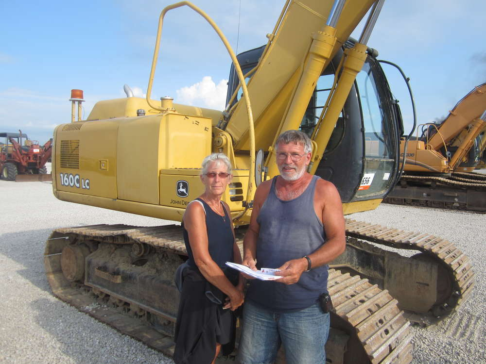 Susan and Kevin Shaw, owners of Shaw Construction, consider bidding on this John Deere 160C excavator.