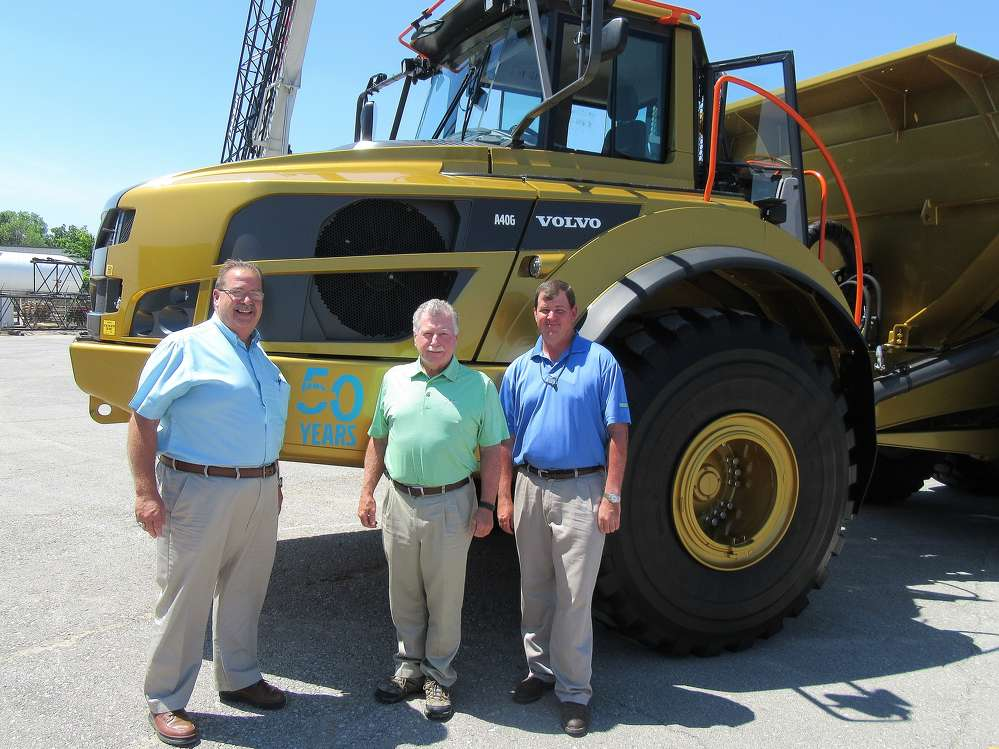 (L-R): Albert Medcalf, Rudd Equipment Company general manager of used equipment, joins Ken Rush of Irving Materials and Jamie Terrill III, Louisville branch VP of Rudd Equipment Company, to admire Volvo's 50th Anniversary Golden Hauler.