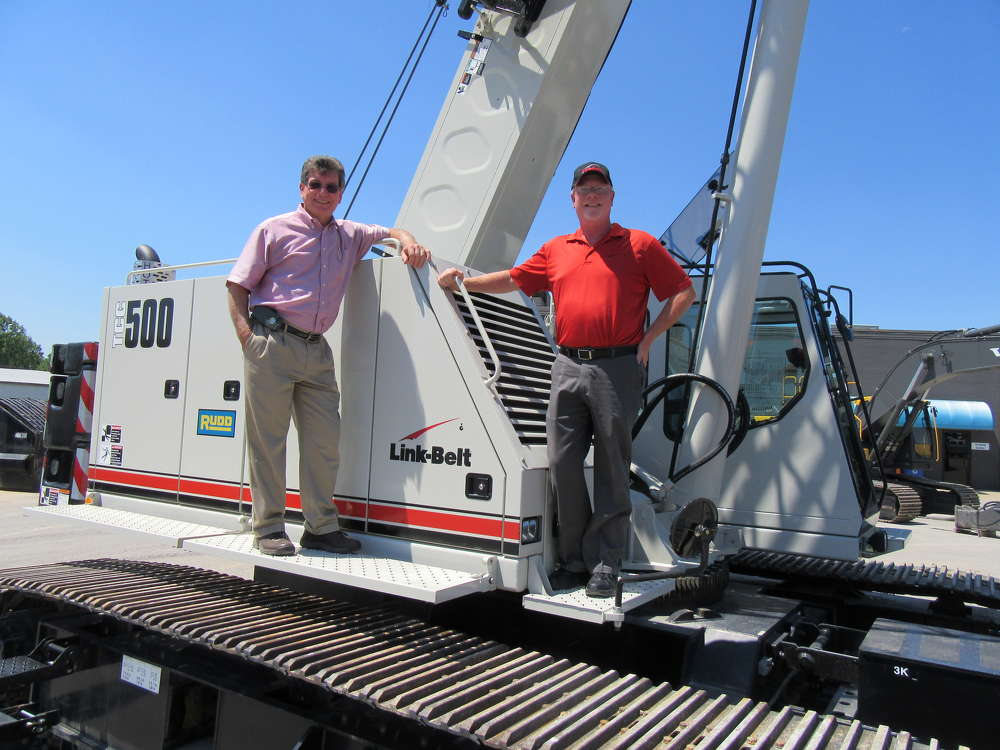 Mike Huffman (L), Rudd Equipment Company's director of crane sales, and David Peters, district service representative of Link-Belt Construction Equipment, talk about this Link-Belt TCC 500 telescopic crawler crane.