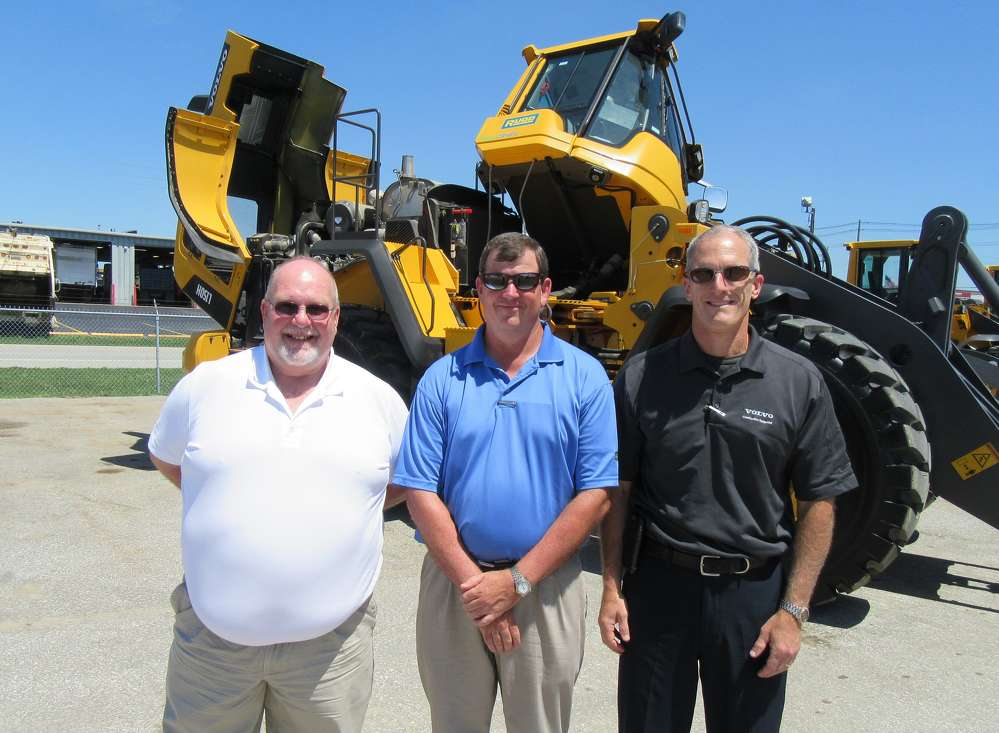Jamie Terrill III, Louisville branch vice president of Rudd Equipment Company, is flanked by Andy Capps (L), district products representative, Volvo, and Tony Spake, Volvo director key accounts, to present Volvo's L150H wheel loader with a tilting cab for improved service and maintenance access.