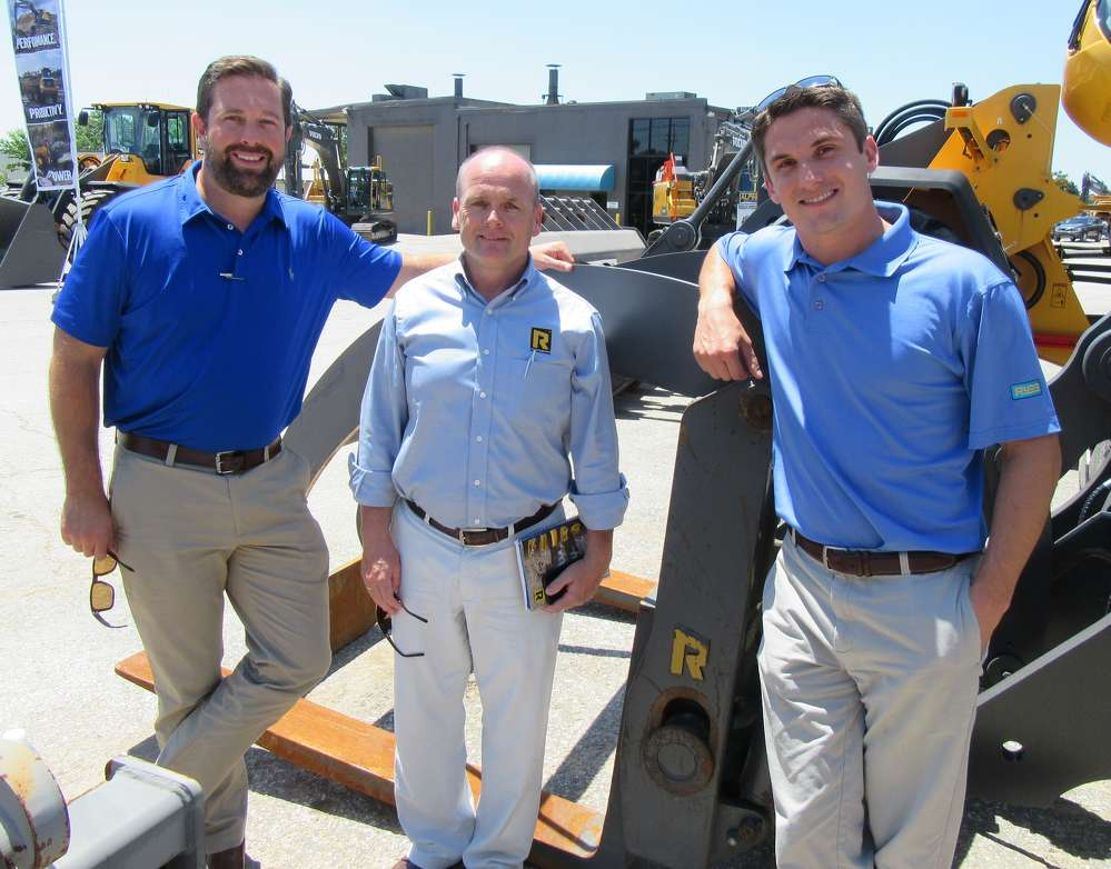 (L-R): Brad Kerkhoff of Machinery Services Corporation; Mark Flynn of Rockland Manufacturing; and Craig Kerkhoff, Rudd Equipment Company attachment specialist, discuss Rockland attachments at the event.