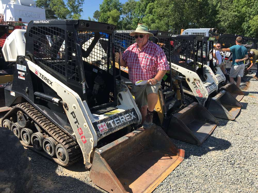Dale Mason of Mason Equipment in Tri Cities, Tenn., looks over the selection of compact track loaders, backhoes and skid steer loaders.
