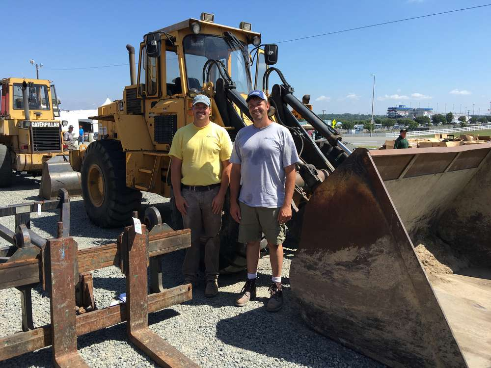 Jeremy (L) and Chad Vriesma, both of Central Piedmont Builders, need a wheel loader for an upcoming project.