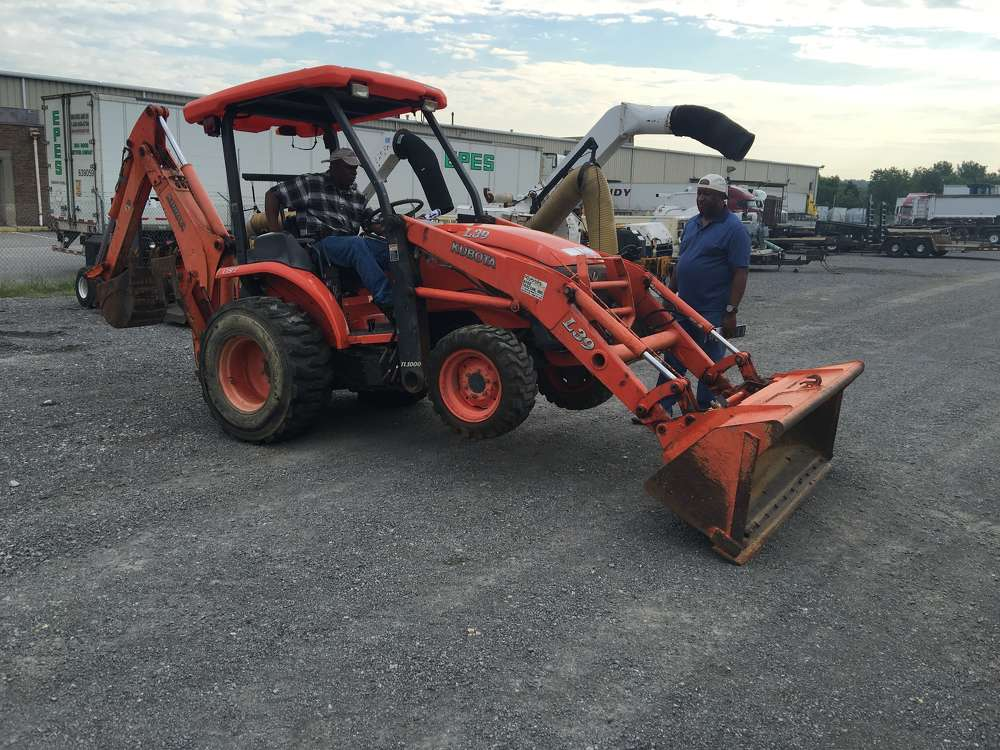 Bay Claiborne (L) of Bay Contracting in Dinwiddie, Va., and Kenny Williams of Williams Excavating in Chester, Va., look over this Kubota L39 backhoe.