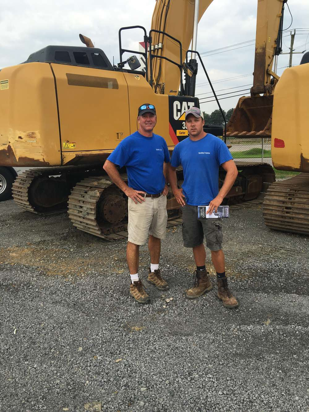 Woody (L) and Conner Hall, both of Raindrop Excavating in Richmond, Va., look for a dozer and an excavator.