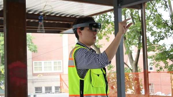 Gilbane's John Myers uses HoloLens to review a virtual 3-D model of Boston's Dearborn STEM Academy. (MIT Technology Review photo)