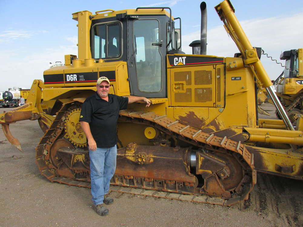 Trent Diekhoff of ETI Equipment & Truck, Loveland, Colo., checks out all the whistles and bells on this Cat D6R XL.