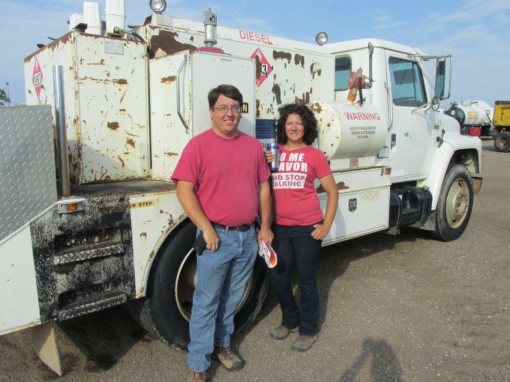 Scott Lesuer (L) and Ashley Sanders of Rensel Construction in Central, Colo., pause for a photo with this International field service truck.