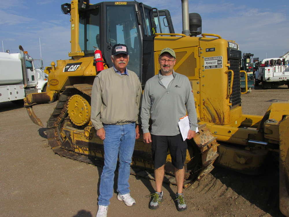 Mark Nowicki (L) and his nephew, Ken Nowicki, president of M & M Excavating Inc., Gaylord, Mich., came a long way to bid on this Cat D6N dozer.