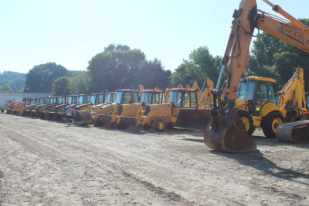 Backhoe loaders were lined up and ready to go.