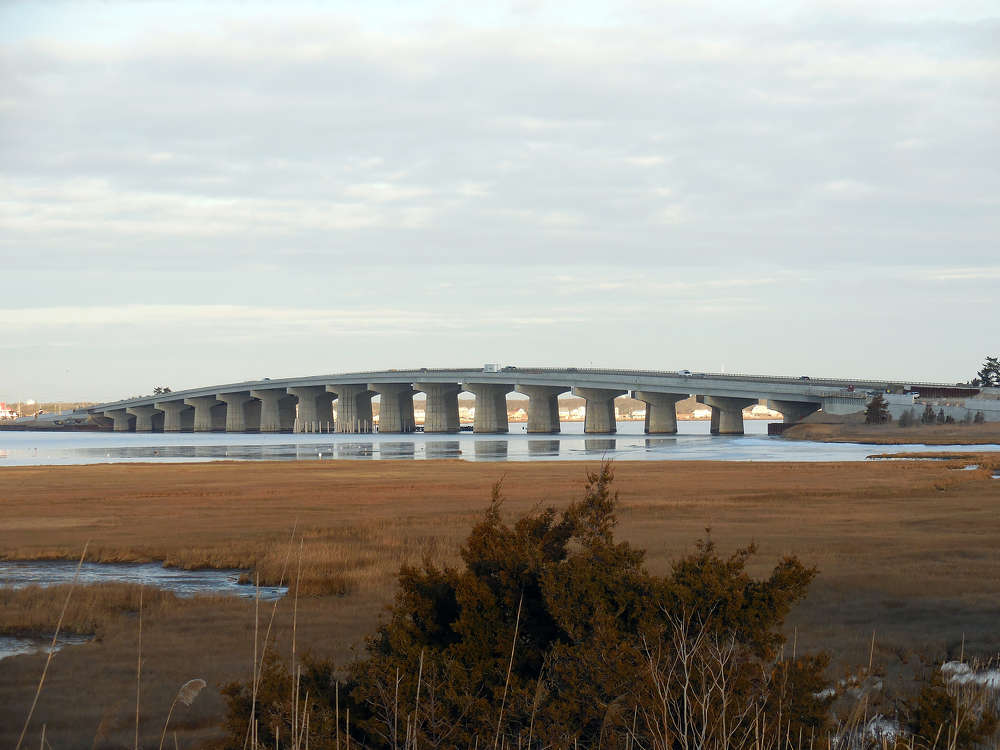 NJDOT photo. Looking northwest, this view is from the south side of the Cedar Bonnet Island, of the new Manahawkin Bay Bridge. The construction access bridge has been completely removed and all its foundation elements have been cut below the mudline in the bay.