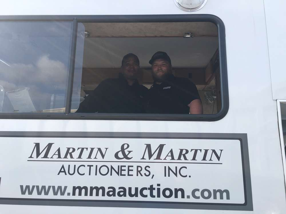 Joseph Pelaez (L), EquipmentFacts.com, and Kevin McGee, Martin & Martin, prepare for the auction.