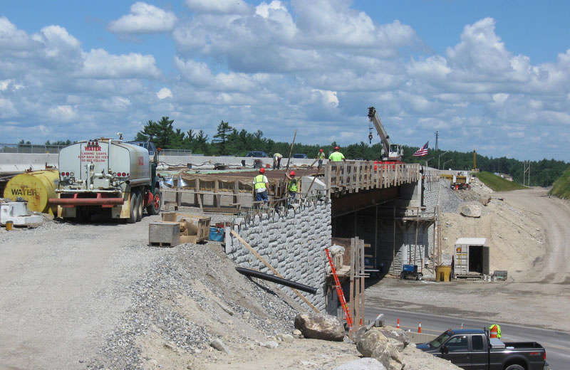 NHDOT photo Exit 5 Mainline — Repair work on southbound bridge over NH-38 at Exit 5, July 2012.